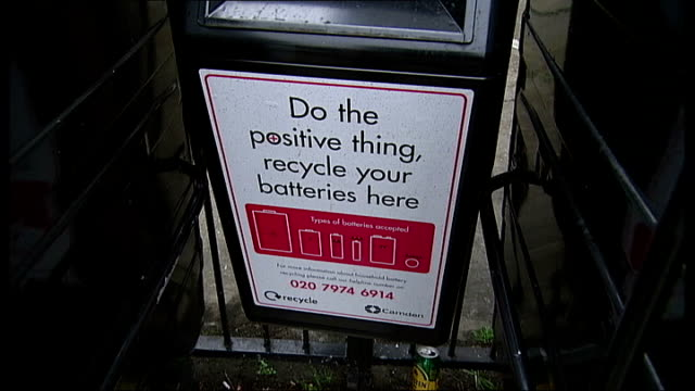 stockvideo's en b-roll-footage met london camden kentish town ext onstreet recycling facilities next residential tower block including instructions sign bins for food and drinks cans... - kentish town