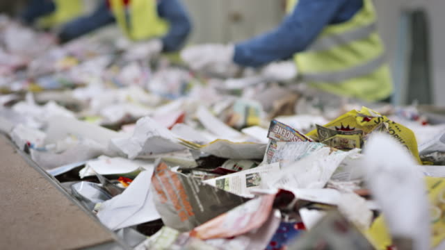 recycling facility workers sorting the waste paper by hand - recycling stock videos & royalty-free footage