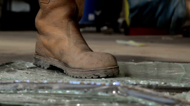 recycling glass windows in work boots - boot stock videos & royalty-free footage