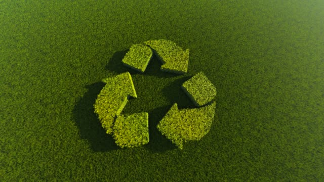 recycling symbol made of green grass - logo stock videos and b-roll footage