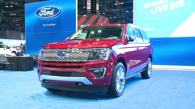 red 2018 ford expedition at the 2017 chicago auto show on feb. 10, 2017. - personal land vehicle stock videos & royalty-free footage