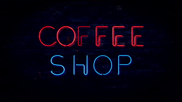 Red and Blue Coffee Shop flashing neon sign