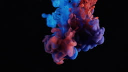 Red And Blue Ink Dropped In Water Black Background