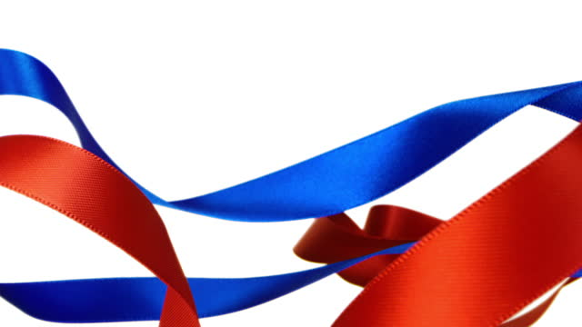 red and blue ribbons on white background, for celebration events and party for new year, birthday party, christmas or any holidays, waiving and curling in super slow motion and close up - loopable moving image stock videos & royalty-free footage