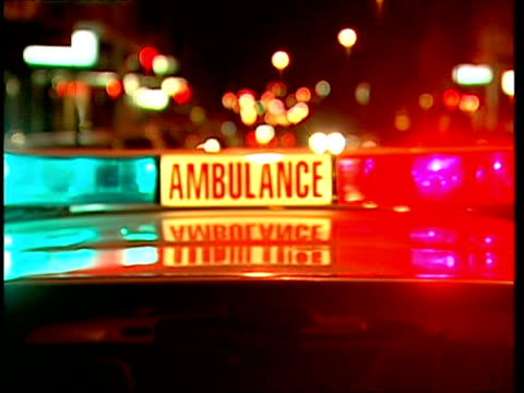 CU Red and blue roof lights flashing on ambulance