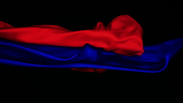 red and blue silky fabric flowing and waving horizontally in super slow motion and close up, black background - red stock videos & royalty-free footage