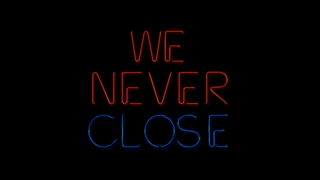 Red and blue We Never Close flashing neon sign