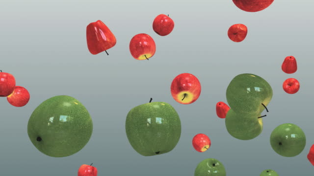 cgi red and green apples thrown in air against gray background - digital animation stock videos & royalty-free footage