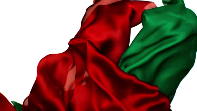 red and green silky fabrics flowing and waving upward in super slow motion and close up, white background - silk stock videos & royalty-free footage