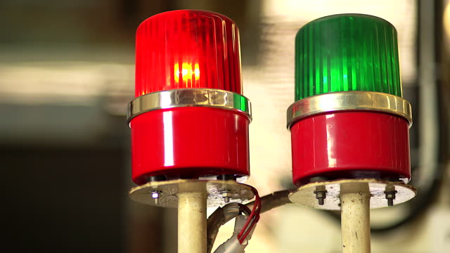 Red and Green siren on the metal cabinet. Warning light for safety in a work area.
