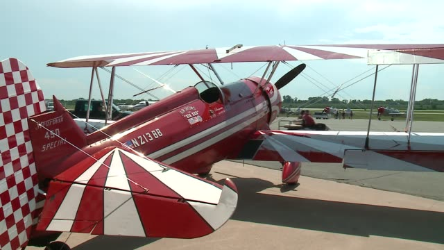 """red and white 1942 boeing stearman biplane called """"big red"""" at the gary/chicago international airport before the 2016 chicago air and water show. - chicago air and water show stock videos & royalty-free footage"""