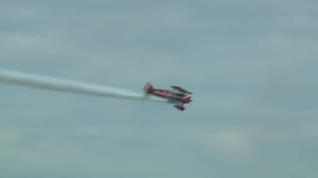 """red and white biplane called """"big red"""" flying at the 2016 chicago air and water show. - chicago air and water show stock videos & royalty-free footage"""