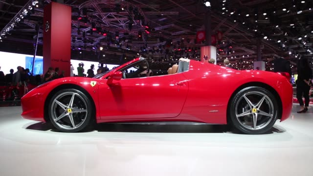 vidéos et rushes de red and white ferrari spa automobiles sit on display at the companys display area during the preview day at the paris motor show in paris, france, on... - voiture particulière