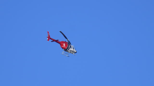 a red and white fire helicopter flies away. - number 6 stock videos & royalty-free footage