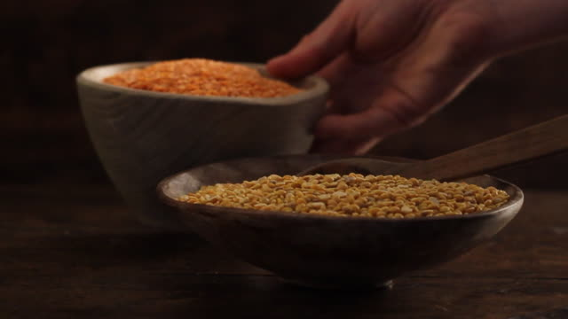 cu red and yellow lentils in traditional rustic setting dahl / london, uk - dahl stock videos and b-roll footage