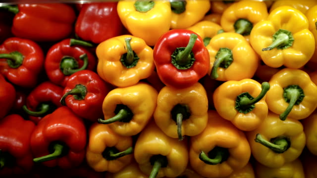 red and yellow paprika -b roll - pepper vegetable stock videos & royalty-free footage