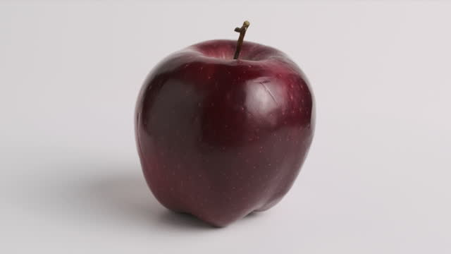 red apple rotating on white background - apple fruit stock videos & royalty-free footage