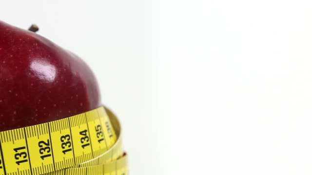 red apple with tape measure - textfreiraum stock videos & royalty-free footage