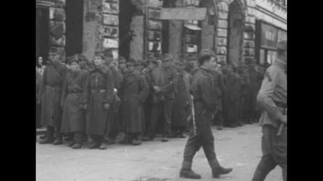 [red army footage of vienna offensive of world war ii] red army soldiers on street unspooling wire pan to devastated building / military truck speeds... - union army stock videos and b-roll footage