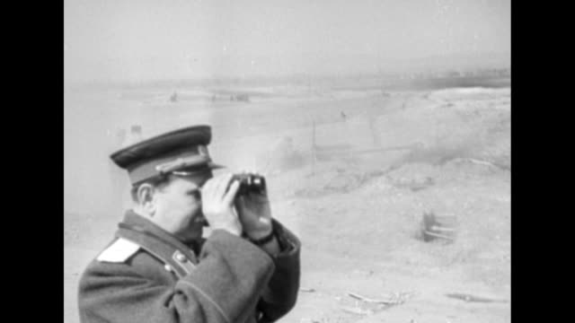 [Red Army footage of Vienna Offensive of World War II] VS Red Army artillery guns fire / officers in trench look through field glasses / gunfire /...