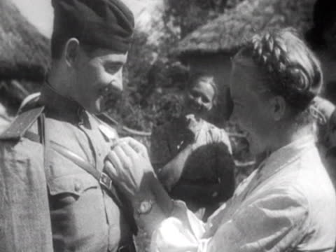 red army lieutenant ivan noga returning to his home village after world war ii. embracing his wife and meeting family. - 1944 stock videos & royalty-free footage
