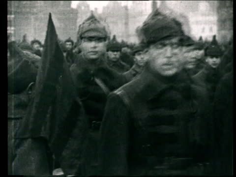 1925 MONTAGE B/W MS Red Army soldiers marching past on street during military parade/ WS Red Army soldiers riding past in cars/ WS Red Army vehicles driving past/ Moscow, Russia
