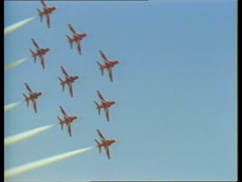 red arrows cyprus ms batmen stand as two red arrow planes taxi akrotiri ms plane lr as others parked in b/g a planes in flight bank lr in formation... - eurasia stock videos and b-roll footage