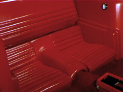 1965 red back seats of ford mustang / man's hand folds down seat back to make cargo deck - ford mustang stock videos and b-roll footage