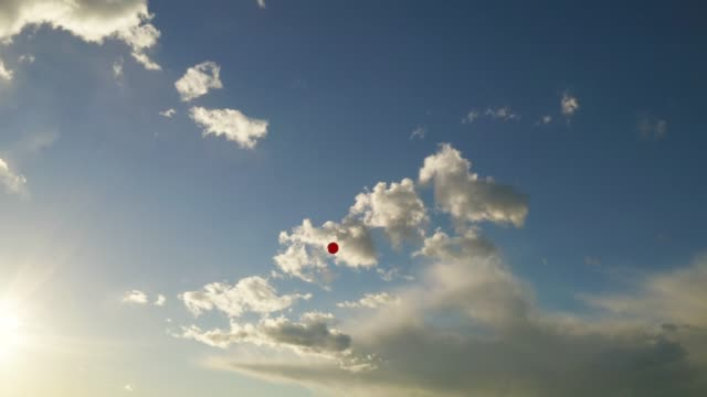 red balloon floating into the sky - single object stock videos & royalty-free footage