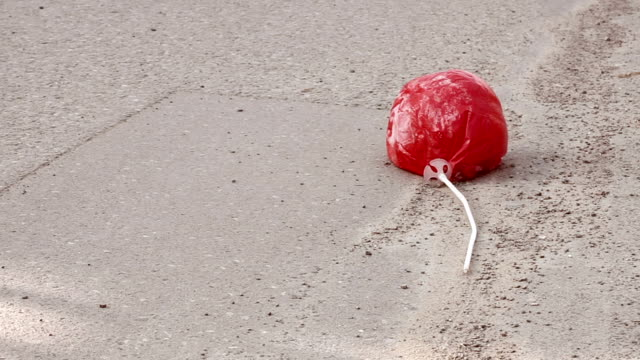 Red balloon on the road