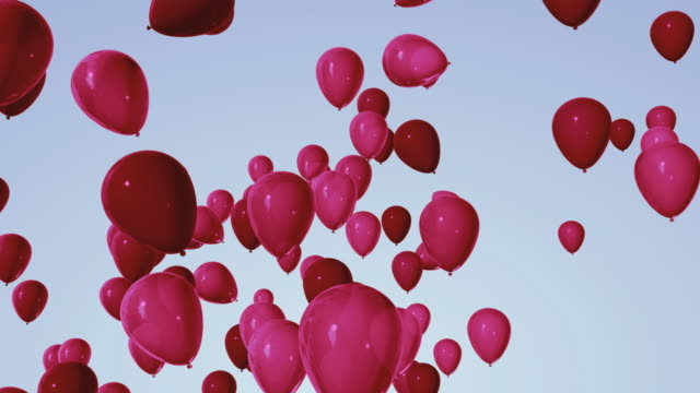 cgi red balloons floating against blue background - abundance stock videos & royalty-free footage