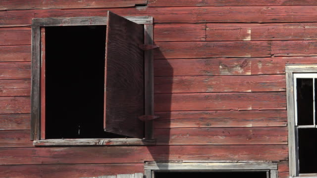 red barn window shuts by itself - ajar stock videos & royalty-free footage