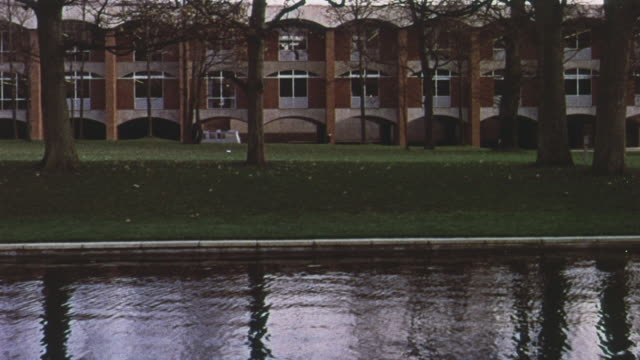 1965 PAN Red brick buildings and grounds at Sussex University as students are walking around the campus / Brighton, England , United Kingdom