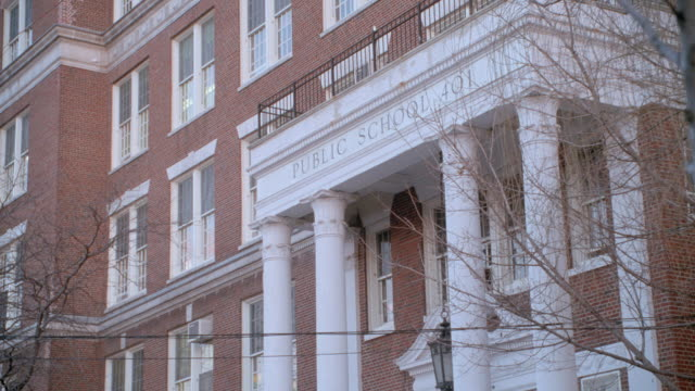 a red brick school building features white columns and window frames. - 2001 stock videos & royalty-free footage
