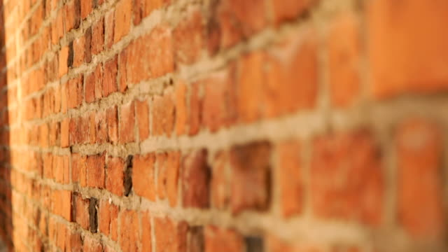 red brick wall grunge texture - brick stock videos & royalty-free footage