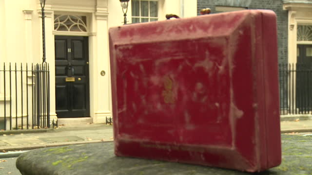 red budget box outside number 11 downing street, home of chancellor of the exchequer, ahead of the 2021 budget - box container stock videos & royalty-free footage