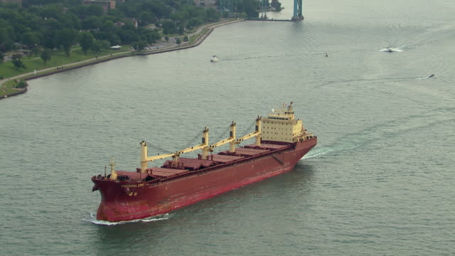 windsor, ontario - july 7, 2011: a red bulker, the federal ems, sails on the detroit river between detroit, michigan and windsor, ontario. - detroit river stock-videos und b-roll-filmmaterial