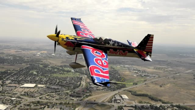 Red bull athlete and five time US national aerobatic champion Kirby Chambliss flies his Edge 540 over Broomfield CO while practicing for the 2012...