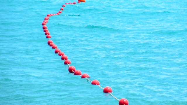 Red buoys on blue sea surface