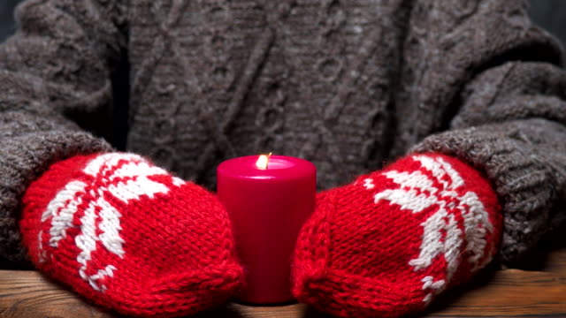 red candle in hands - mitten stock videos and b-roll footage