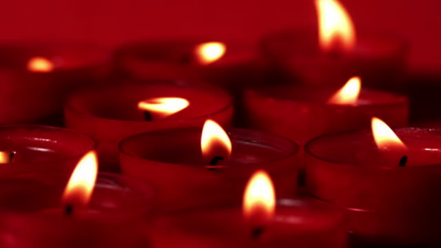 Red candles flickering in the breeze