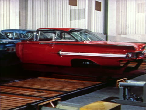 1959 red car body moving on assembly line / 1960 chevy - car plant stock videos & royalty-free footage