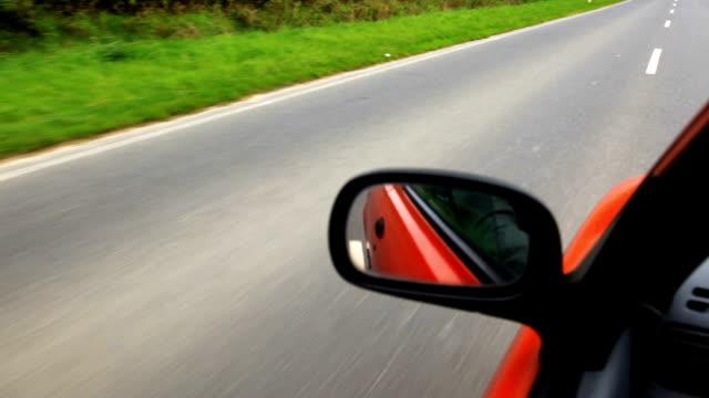 Red car side mirror