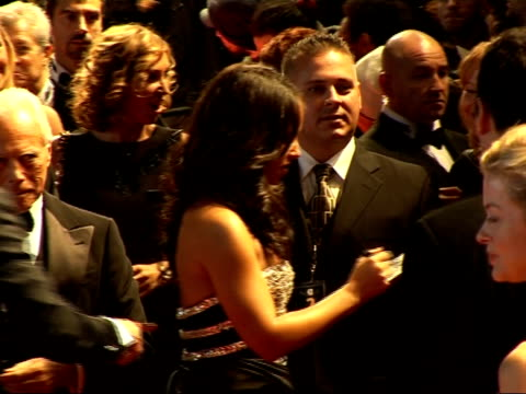 Red carpet arrivals and interviews at Fashion Rocks 2007 Alicia Keys signing autographs as Giorgio Armani looks on / Keys wearing black and silver...