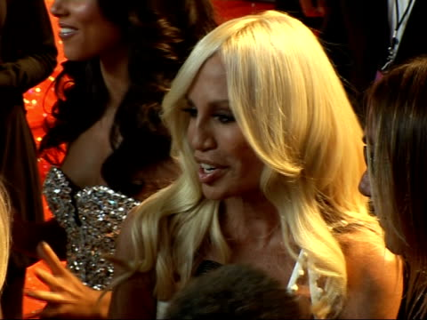 red carpet arrivals and interviews at fashion rocks 2007; side view of donatella versace wearing white strapless dress and iggy pop wearing a versace... - strapless stock videos & royalty-free footage