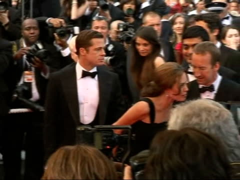 Red carpet arrivals / Angelina Jolie and Brad Pitt press conference FRANCE Cannes EXT **flash photography** Angelina Jolie and Brad Pitt along on red...