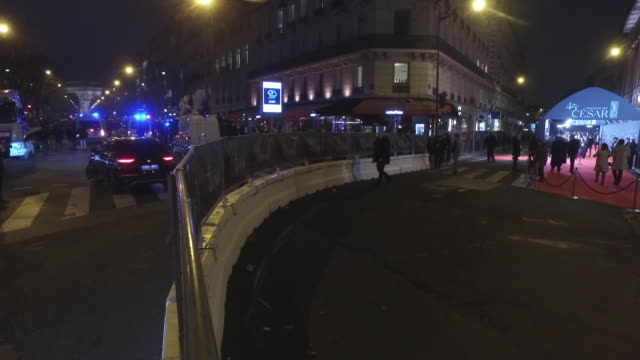 red carpet at the official entrance to the pleyel hall for the cesar ceremony and avenue hoche with police vehicles to prevent the demonstrators from... - lynching stock videos & royalty-free footage