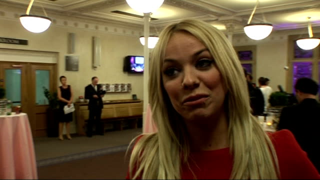 red carpet interview at the 2010 inspiration awards; liz mcclarnon interview sot unidentified woman posing for press stefan booth interview sot - リズ・マクラーノン点の映像素材/bロール