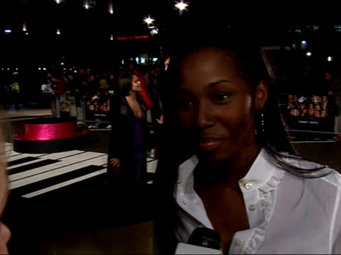 Red carpet interviews at Leicester Square premiere of 'Music and Lyrics' Jamelia interview SOT Because it is about music / From the 1980s I like Wham...