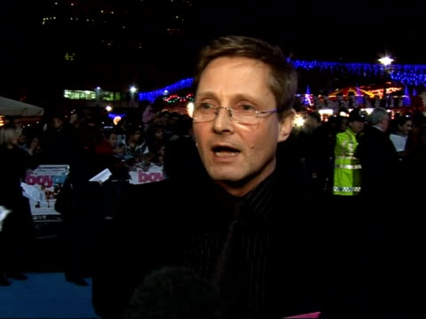 Red carpet interviews at premiere of 'It's a Boy Girl Thing' Elton John and David Furnish along on red carpet talking to fans/ Nick Hurran interview...